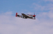 A vintage World War II P51 Mustang fighter plane flies past the grandstands during the Reno National Championship Air Races on September 13 in Reno...
