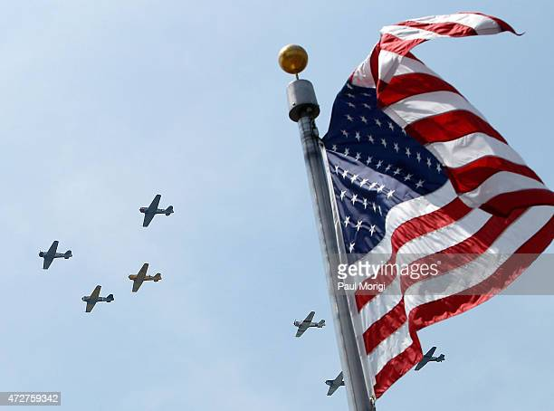 Vintage World War II planes fly over the National World War II Memorial to commemorate the 70th Anniversary of Victory in Europe on May 8 2015 in...