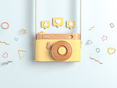 Vintage yellow wooden photo camera with Pin heart, friends, comment, post. Overhead view of Traveler's accessories, Flat lay photography of Travel concept. white isolated background. 3d render