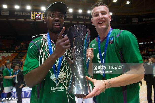 Viny Okouo #2 of Unicaja Malaga and Alen Omic #92 poses with Champion Trophy at the end of the 20162017 7Days Eurocup Finals Leg 3 Valencia Basket v...