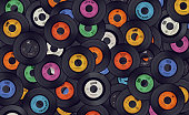 A background of vinyl records. The labels are not real but fake artists, producers, legal text and logo's.