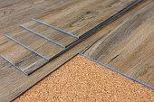 New luxury vinyl plank installation on cork,modern home,renovate concept