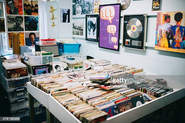 Vinyl records for sale, a record shop, Pop music posters