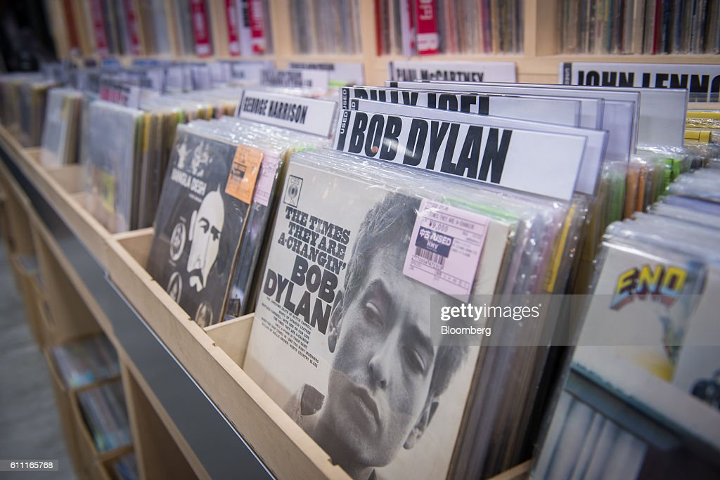 Vinyl records, including Bob Dylan's 'The Times They Are A-Changin',' are displayed for sale at the HMV Record Shop operated by Lawson HMV Entertainment Inc. in the Shibuya district of Tokyo, Japan, on Wednesday, Sept. 28, 2016. Spotify Ltd. is bringing its popular online music service to Japan, a large and lucrative market where fans have demonstrated a continuing fondness for CDs and even vinyl records. Photographer: Noriko Hayashi/Bloomberg via Getty Images