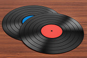 Vinyl records on the wooden table. 3D rendering