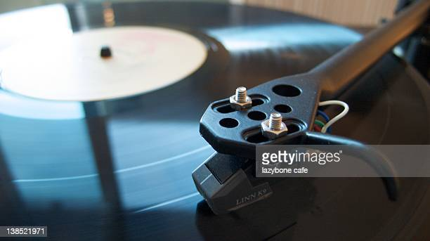 Vinyl records playing on turntable
