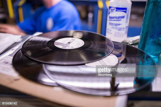 Vinyl records sit on a shelf at the Precision Record Pressing facility in Burlington Ontario Canada on Friday June 30 2017 Precision is the world's...