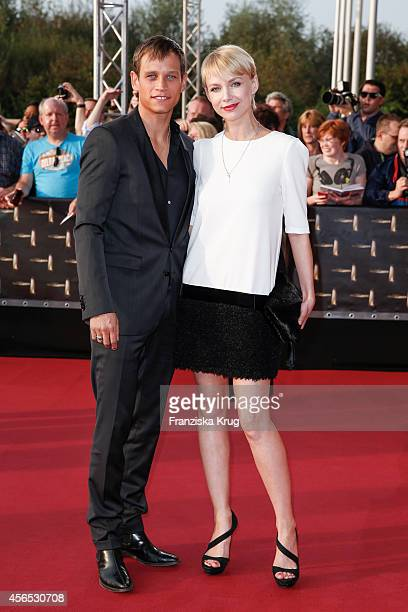 Vinzenz Kiefer and Masha Tokareva attend the red carpet of the Deutscher Fernsehpreis 2014 on October 02 2014 in Cologne Germany