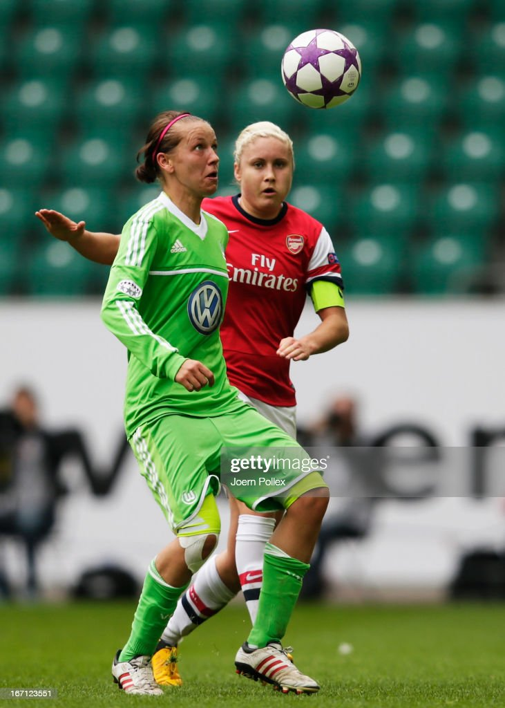 Viola Odebrecht (L) of Wolfsburg and Stephanie Houghton of Arsenal compete for the ball during the Women's Champions League semi-final second leg match between VfL Wolfsburg and Arsenal Ladies FC at Volkswagen Arena on April 21, 2013 in Wolfsburg, Germany.