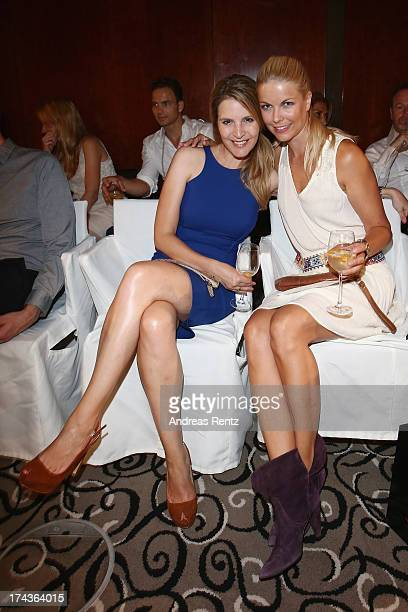 Viola Weiss and Tina Kaiser attend the Marcel Ostertag fashion show at Charles Hotel on July 24 2013 in Munich Germany
