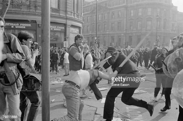 Violence breaks out in Trafalgar Square after a demonstration against the Poll Tax turned into a largescale riot London 31st March 1990