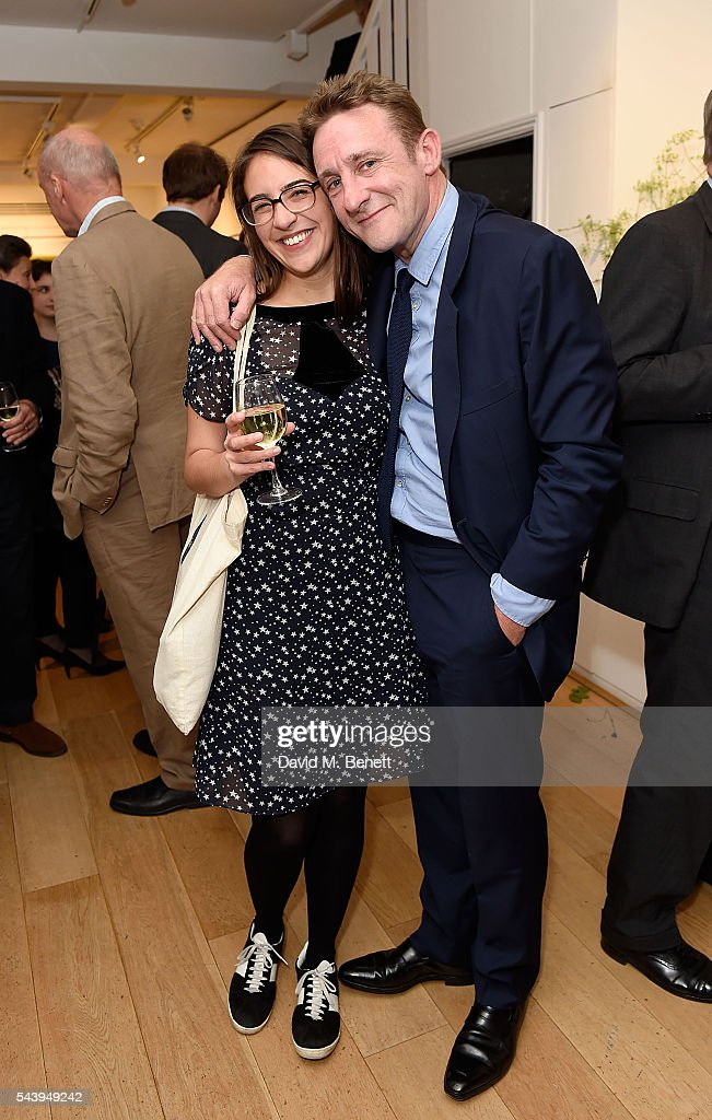 Violet Hudson and Jolyon Fenwick attend the exhibition launch party of 'The Zero Hour Panoramas' by Jolyon Fenwick. The exhibition consists of 14 photographic panoramas showcasing, '100 Years on: Views From The Parapet of the Somme', at Sladmore Contemporary on June 30, 2016 in London, England.