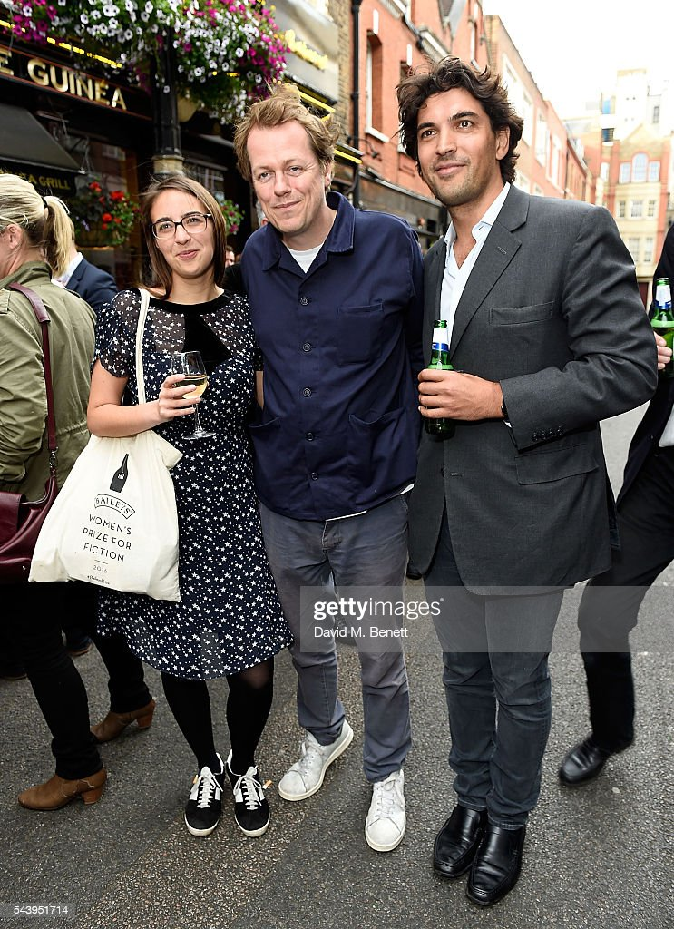 Violet Hudson, Tom Parker Bowles and Sebastian Lee attend the exhibition launch party of 'The Zero Hour Panoramas' by Jolyon Fenwick. The exhibition consists of 14 photographic panoramas showcasing, '100 Years on: Views From The Parapet of the Somme', at Sladmore Contemporary on June 30, 2016 in London, England.