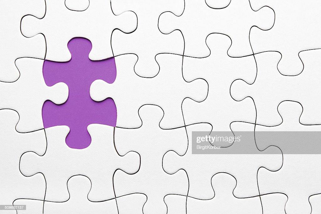 Violet puzzle piece missing : Stock Photo