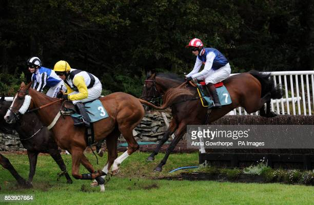 Violets Boy ridden by Brendan Powell clear a fence during the William Hill On Your Mobile Handicap Steeple Chase at Cartmel Racecourse Cartmel Cumbria
