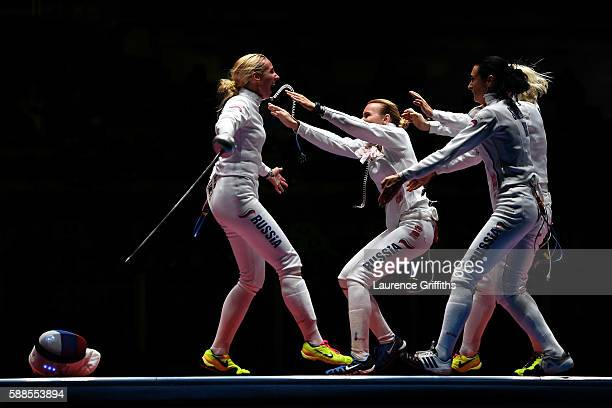 Violetta Kolobova of Russia is swarmed by her teammates after defeating Irina Embrich of Estonia to help Russia win the Women's Epee Team Bronze...