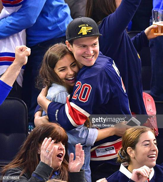 Violetta Komyshan and Ansel Elgort attend the Tampa Bay Lightning vs New York Rangers playoff game at Madison Square Garden on May 16 2015 in New...