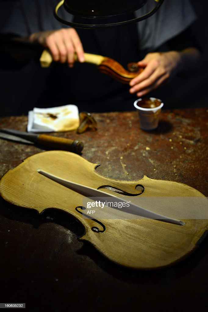 A violin being restored is displayed in the workshop of Mathias Menanteau, a French violin maker on January 30, 2013 in Rome. After studying and working in England and Germany, Menanteau setup his workshop in the Italian capital, where he builds and restores violins and cellos for notorious musicians.