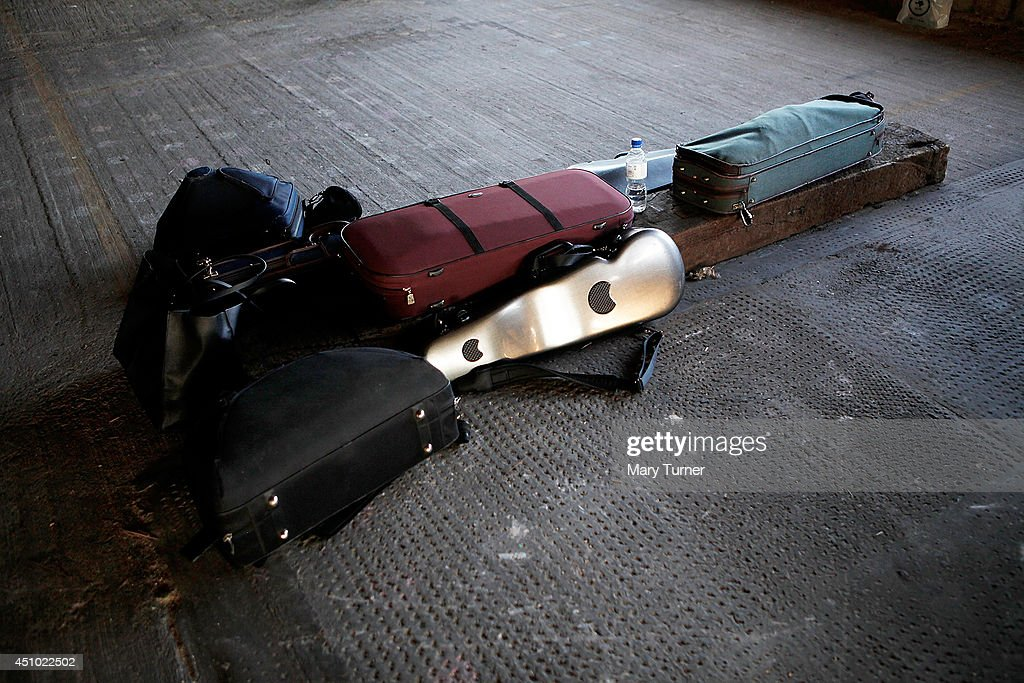 Violin cases lie on the floor of Peckham Rye car park where the MultiStory Orchestra performed Jean Sibelius' 5th Symphony on June 21 2014 in London...
