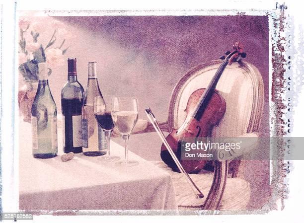 Violin in Chair Next to Wine Bottles