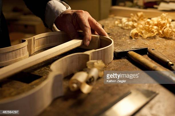 violin maker at work, close-up of hands