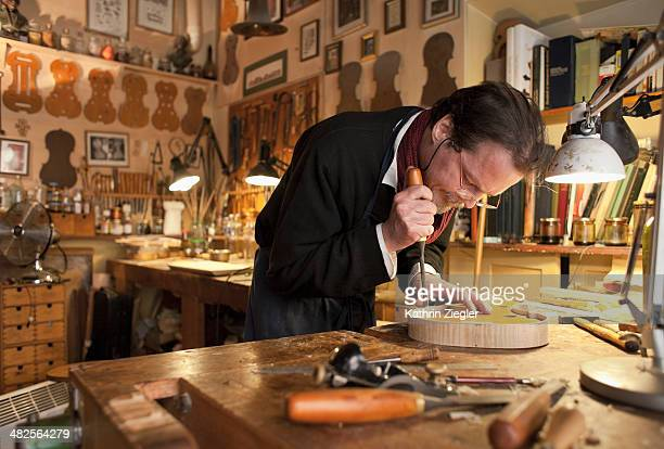 violin maker at work in his studio