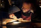 violin maker at work in his studio