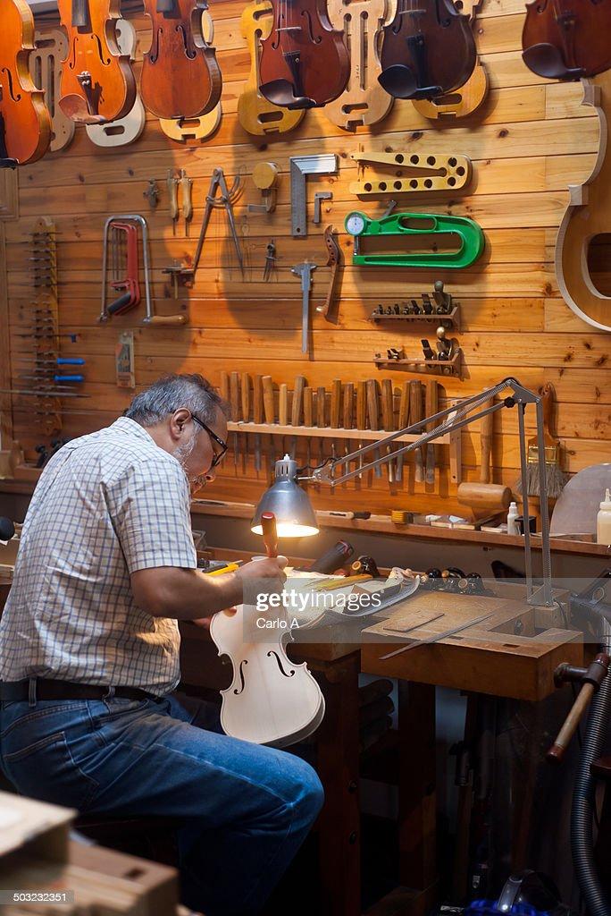 Violin maker in his studio.