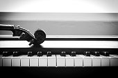 Violin on piano. Black and White color tone. Art and music concept. Still life and hight contrast style. With dark vignette.