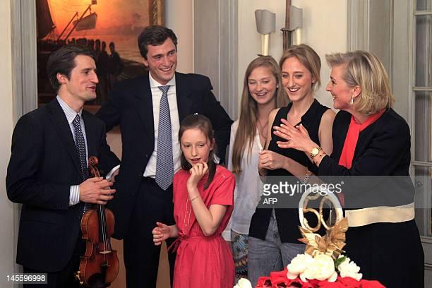 Violin player Lorenzo Gatto Prince Amedeo Princess Laetitia Maria Princess Luisa Maria Princess Maria Laura and Princess Astrid of Belgium smile...