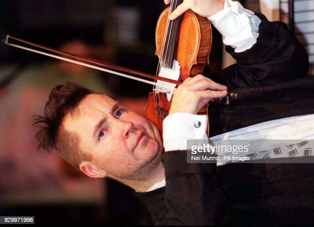 Violin player Nigel Kennedy playing during a special oneoff performance of the Elgar Violin Concerto at the Virgin Megastore in London's Oxford...