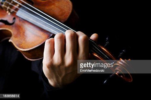 Violin player on a black background