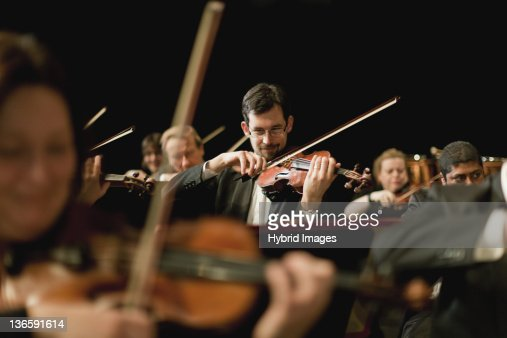 Violin players in orchestra