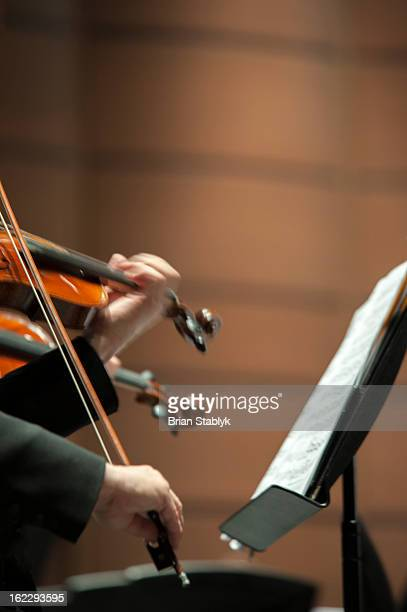Violin players in symphony orchestra