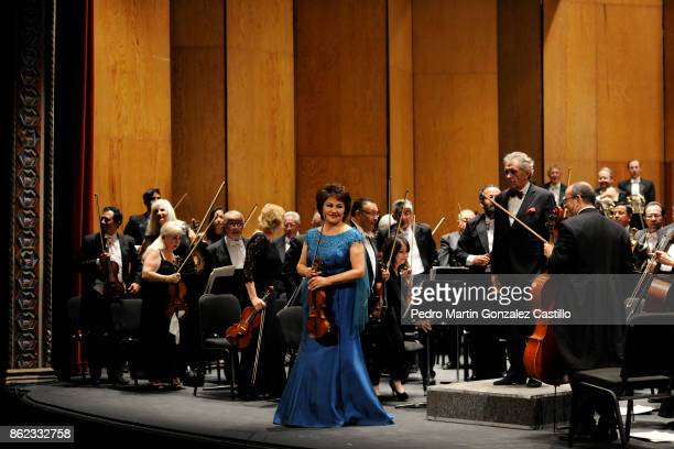 Violinist Aiman Mussakhajayeva greets the audience along with the Symphonic Orchestra of Mexico during the 45th Cervantino International Festival at...