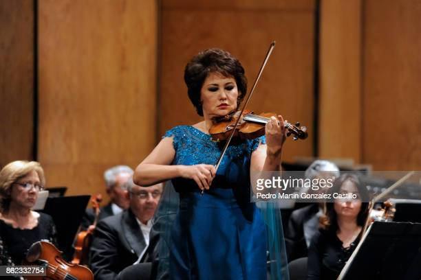 Violinist Aiman Mussakhajayeva performs with the Symphonic Orchestra of Mexico during the 45th Cervantino International Festival at Juarez Theater on...