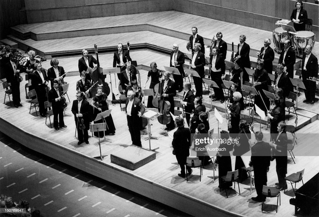 Violinist and conductor Harry Blech (1910 - 1999) leads the London Mozart Players, 30th June 1976. Blech founded the orchestra in 1949.