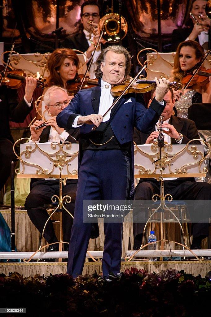 Violinist <a gi-track='captionPersonalityLinkClicked' href=/galleries/search?phrase=Andre+Rieu&family=editorial&specificpeople=1016048 ng-click='$event.stopPropagation()'>Andre Rieu</a> and his orchestra perform live on stage during a concert at O2 World on February 5, 2015 in Berlin, Germany.