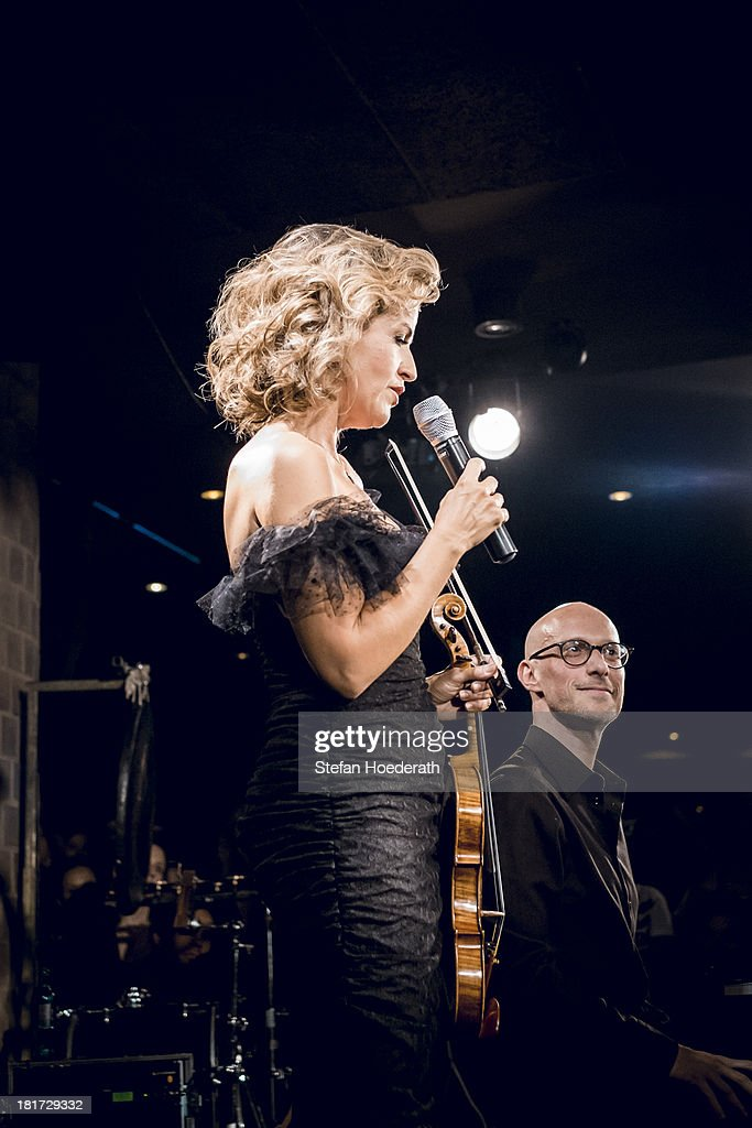 Violinist Anne-Sophie Mutter and Pianist Michael Abramovich perform live during a Yellow Lounge organized by recording label Deutsche Grammophon at Asphalt nightclub on September 03, 2013 in Berlin, Germany.
