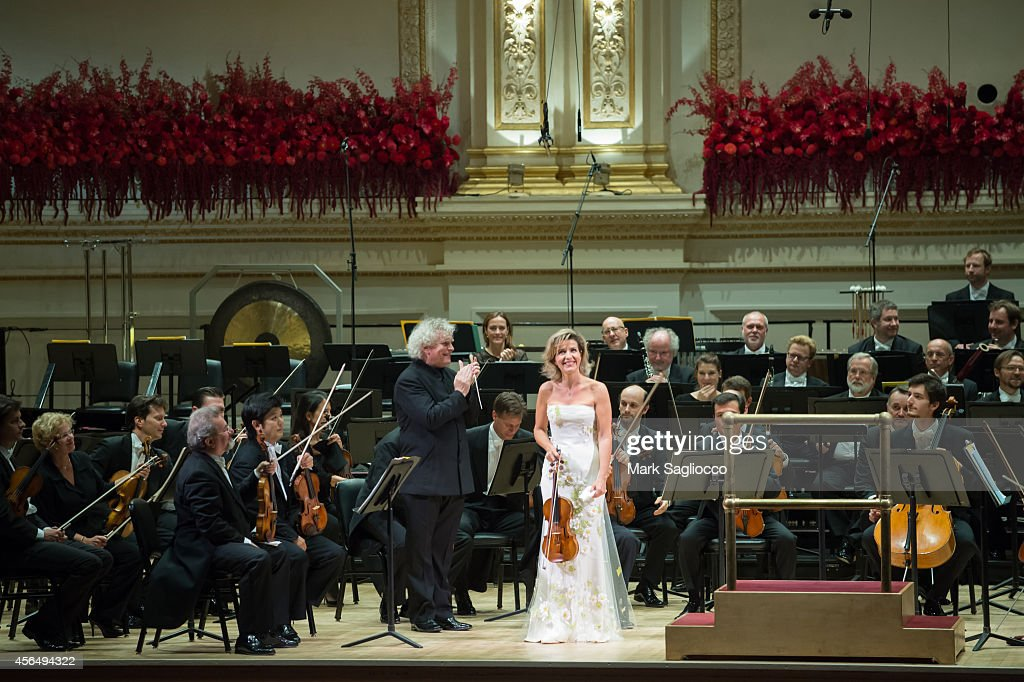 Violinist <a gi-track='captionPersonalityLinkClicked' href=/galleries/search?phrase=Anne-Sophie+Mutter&family=editorial&specificpeople=784120 ng-click='$event.stopPropagation()'>Anne-Sophie Mutter</a> performs Violin Concerto No. 1 with the Berliner Philharmoniker Orchestra led by Sir <a gi-track='captionPersonalityLinkClicked' href=/galleries/search?phrase=Simon+Rattle&family=editorial&specificpeople=1616309 ng-click='$event.stopPropagation()'>Simon Rattle</a> at Carnegie Hall's Opening Night Gala on October 1, 2014 in New York City.