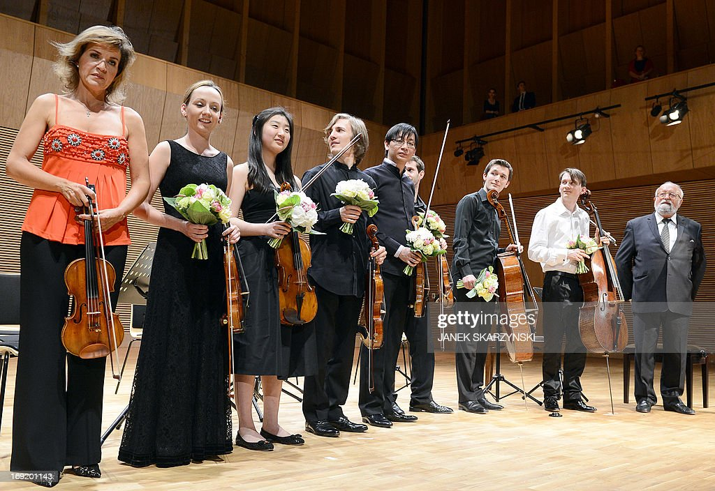Violinist Anne-Sophie Mutter (L) with members of Mutter's Virtuosi and Polish composer Krzysztof Penderecki (R) stand at the stage during opening of Krzysztof Penderecki European Centre for Music in Luslawice, south-east Poland on May 21, 2013. AFP PHOTO / JANEK SKARZYNSKI