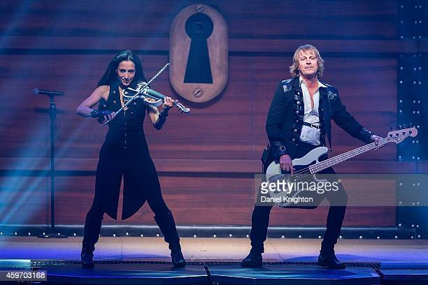 Violinist Asha Mevlana and bassist John Lee Middleton of TransSiberian Orchestra perform on stage at Viejas Arena on November 28 2014 in San Diego...