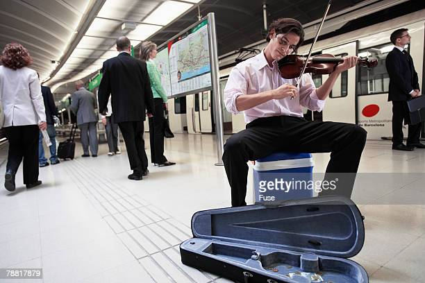 Violinist Busking in Subway Station