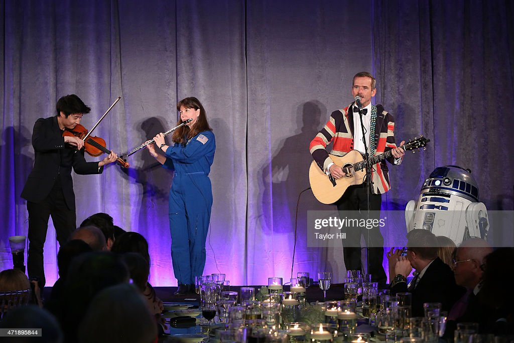 Violinist Charles Yang, astronaut Cady Coleman, and astronaut Chris Hadfield perform during Genius Gala 4.0 at Liberty Science Center on May 1, 2015 in Jersey City, New Jersey.