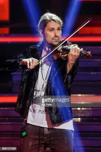 Violinist David Garrett performs during the tv show 'Willkommen bei Carmen Nebel' at TUI Arena on September 30 2017 in Hanover Germany