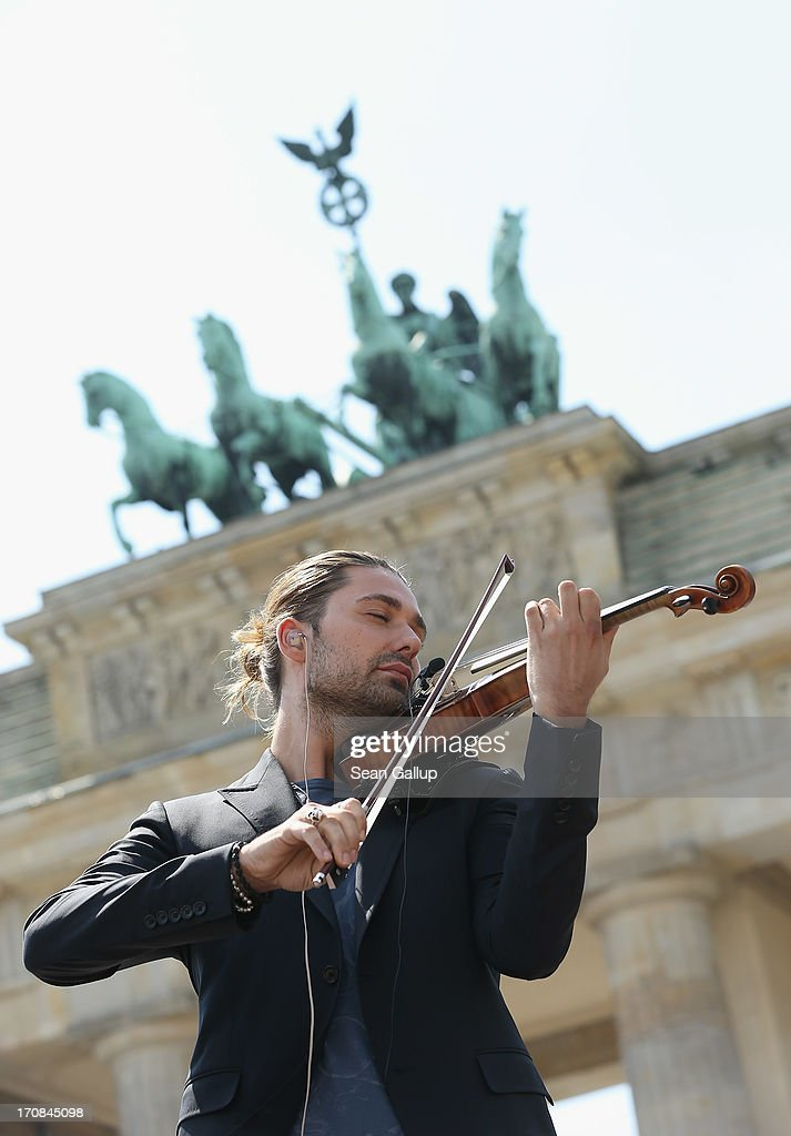Violinist David Garrett plays in front of the Brandenburg Gate prior to the arrival of U.S. President Barack Obama, who is to give a speech there, on June 19, 2013 in Berlin, Germany. Obama is visiting Berlin for the first time during his presidency and his speech at the Brandenburg Gate is to be the highlight. Obama will be speaking close to the 50th anniversary of the historic speech by then U.S. President John F. Kennedy in Berlin in 1963, during which he proclaimed the famous sentence: 'Ich bin ein Berliner.'