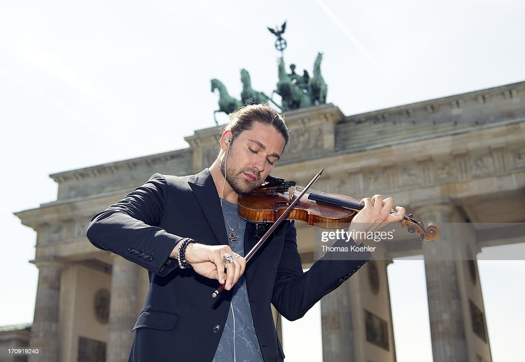 Violinist David Garrett plays in front of the Brandenburg Gate prior to the arrival of US President Barack Obama on June 19, 2013 in Berlin, Germany. Obama is set to speak on the east side of the Brandenburg Gate, 50 years after John F. Kennedy famously declared his solidarity with the citizens of Berlin.