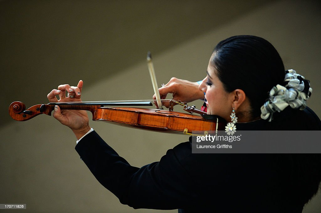 A Violinist entertains the crowd during the FIFA Confederations Cup Brazil 2013 Group A match between Mexico and Italy at the Maracana Stadium on June 16, 2013 in Rio de Janeiro, Brazil.