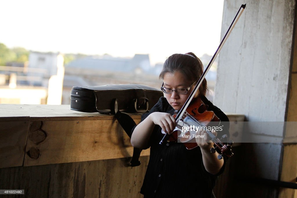 A violinist from the Multi-Story Orchestra practices before a performance of Jean Sibelius' 5th Symphony at the Peckham Rye Car Park on June 21, 2014 in London, England. The performance is one of a series that the orchestra will be performing in the South London car park throughout the summer, hoping to bring classical music to new audiences.
