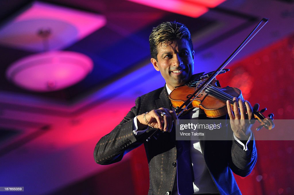 Violinist, G Pinto, interacts with the crowd at the 3rd Annual Helping Hands Fundraising Gala at the Hilton Hotel in Markham in Toronto on November 10, 2013